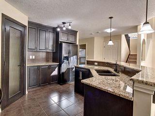 Photo 4: 203 Cimarron Drive: Okotoks Detached for sale : MLS®# A1084568