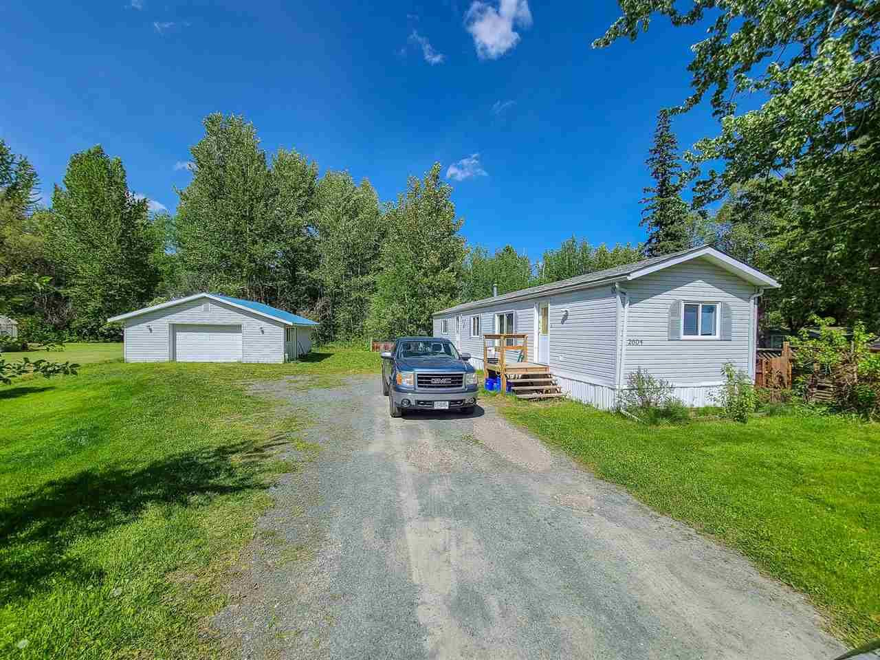 """Main Photo: 2604 MINOTTI Drive in Prince George: Hart Highway Manufactured Home for sale in """"HART HIGHWAY"""" (PG City North (Zone 73))  : MLS®# R2589076"""