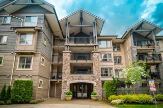 """Photo 2: 409 2958 WHISPER Way in Coquitlam: Westwood Plateau Condo for sale in """"SUMMERLIN"""" : MLS®# R2575108"""
