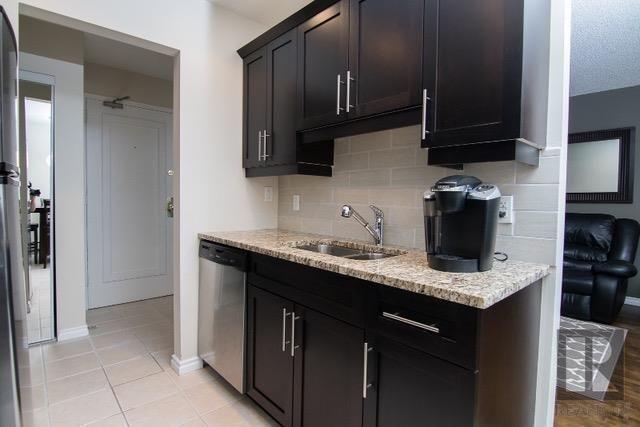 Photo 8: Photos: 306 1710 Taylor Avenue in Winnipeg: River Heights Condominium for sale (1D)  : MLS®# 1820539