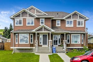 Photo 2: 324B McLeod Crescent: Turner Valley Semi Detached for sale : MLS®# A1117644