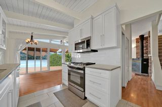 Photo 2: 1026 IOCO Road in Port Moody: Barber Street House for sale : MLS®# R2599599