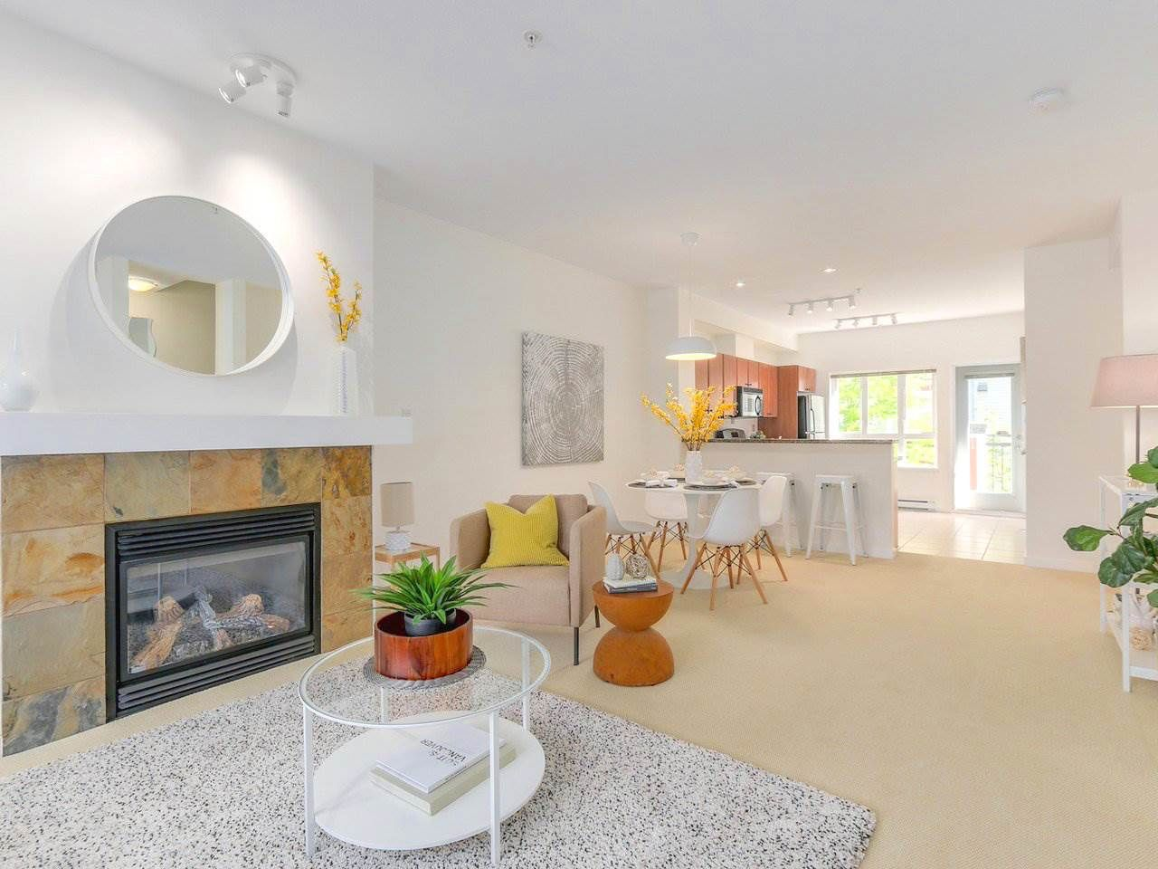 """Main Photo: 3206 E 54TH Avenue in Vancouver: Champlain Heights Townhouse for sale in """"CHAMPLAIN VILLAGE"""" (Vancouver East)  : MLS®# R2287459"""