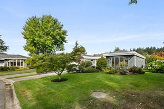 """Photo 4: 109 14271 18A Avenue in Surrey: Sunnyside Park Surrey Townhouse for sale in """"Ocean Bluff Court"""" (South Surrey White Rock)  : MLS®# R2617093"""