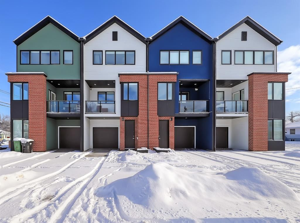 Main Photo: 84 17 Street NW in Calgary: Hillhurst Row/Townhouse for sale : MLS®# A1067122