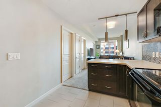Photo 8: 910 1320 1 Street SE in Calgary: Beltline Apartment for sale : MLS®# A1082200