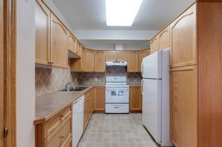 Photo 5: 241 223 Tuscany Springs Boulevard NW in Calgary: Tuscany Apartment for sale : MLS®# A1138362