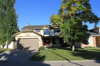 Main Photo: 319 Woodhaven Place SW in Calgary: Woodbine Detached for sale : MLS®# A1147301