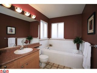 """Photo 7: 18127 68TH Avenue in Surrey: Cloverdale BC House for sale in """"Cloverwoods"""" (Cloverdale)  : MLS®# F1111652"""