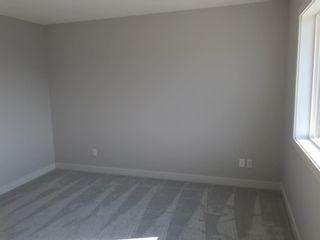 Photo 38: 23 Sunrise Heights: Cochrane Duplex for sale : MLS®# A1017998