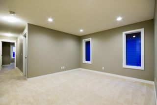 Photo 9: 30 SILVERADO CREST Bay SW in Calgary: Silverado Detached for sale : MLS®# A1019218