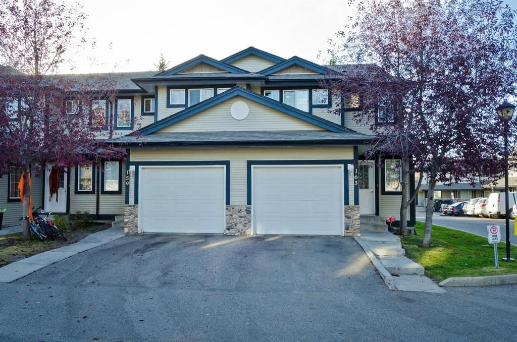 Main Photo: 163 Stonemere Place: Chestermere Row/Townhouse for sale : MLS®# A1040749