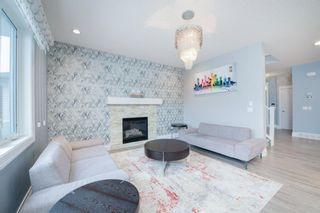 Photo 6: 48 Tremblant Terrace SW in Calgary: Springbank Hill Detached for sale : MLS®# A1131887