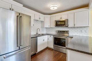 Photo 5: 1524 Ranchlands Road NW in Calgary: Ranchlands Row/Townhouse for sale : MLS®# A1113238