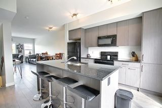 Photo 6: 2103 Jumping Pound Common: Cochrane Row/Townhouse for sale : MLS®# A1119563