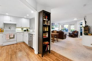 """Photo 2: 101 15290 18 Avenue in Surrey: King George Corridor Condo for sale in """"STRATFORD BY THE PARK"""" (South Surrey White Rock)  : MLS®# R2604945"""