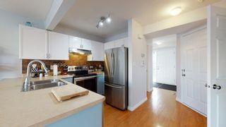 Photo 7: 13948 137 St in Edmonton: House Half Duplex for sale : MLS®# E4235358
