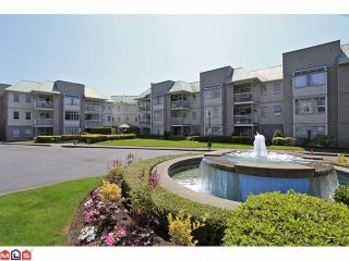 Photo 1: 311 9763 140TH Street in Surrey: Whalley Condo for sale (North Surrey)  : MLS®# F1217814