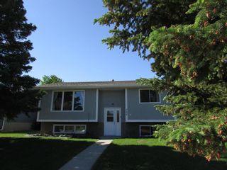 Photo 1: 209 9 Avenue NE: Sundre Detached for sale : MLS®# A1120415
