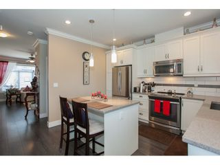 """Photo 13: 23 6929 142 Street in Surrey: East Newton Townhouse for sale in """"Redwood"""" : MLS®# R2110945"""