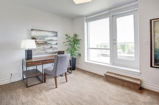 Photo 23: 14601 SHAWNEE Gate SW in Calgary: Shawnee Slopes Row/Townhouse for sale : MLS®# A1051514