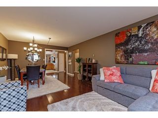 """Photo 16: 103 5641 201 Street in Langley: Langley City Townhouse for sale in """"THE HUNTINGTON"""" : MLS®# R2537246"""