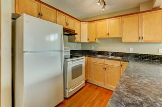 Photo 5: 431 Country Village Cape NE in Calgary: Country Hills Village Row/Townhouse for sale : MLS®# A1043447