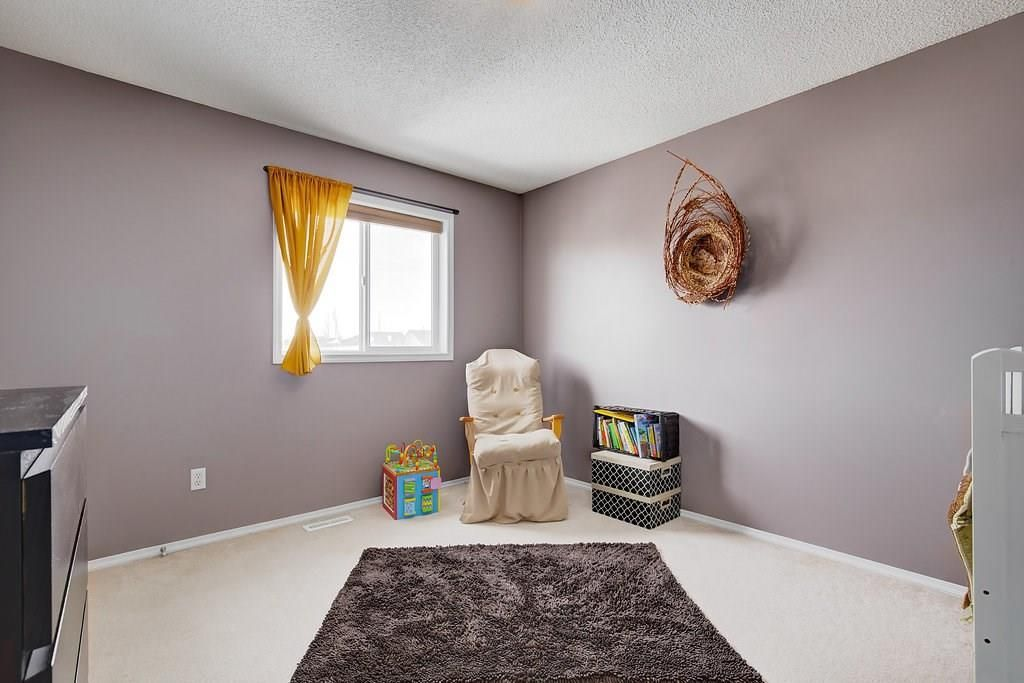 Photo 18: Photos: 32 INVERNESS Boulevard SE in Calgary: McKenzie Towne House for sale : MLS®# C4175544