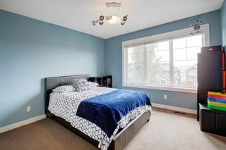 Photo 25: 127 Springbluff Boulevard SW in Calgary: Springbank Hill Detached for sale : MLS®# A1140601