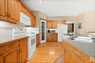 Photo 5: 8 Tuscany Village Court NW in Calgary: Tuscany Semi Detached for sale : MLS®# A1130047