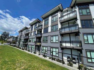 "Photo 2: 403 9983 E BARNSTON Drive in Surrey: Fraser Heights Condo for sale in ""COAST"" (North Surrey)  : MLS®# R2576511"