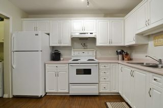 "Photo 9: 105 20200 54A Avenue in Langley: Langley City Condo for sale in ""MONTEREY GRANDE"" : MLS®# F1438210"