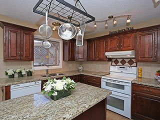 Photo 11: 114 SIGNATURE Close SW in Calgary: Signal Hill House for sale