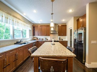 Photo 8: 159 ST MORITZ Drive SW in Calgary: Springbank Hill Detached for sale : MLS®# A1116300