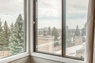 Photo 19: 10 Coach  Manor Rise SW in Calgary: Coach Hill Row/Townhouse for sale : MLS®# A1077472