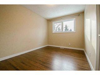 Photo 15: 1708 107 Avenue SW in Calgary: Braeside_Braesde Est Residential Detached Single Family for sale : MLS®# C3651455