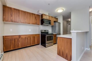 "Photo 1: 114 1033 ST. GEORGES Avenue in North Vancouver: Central Lonsdale Condo for sale in ""Villa St. Geroges"" : MLS®# R2522765"
