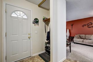 Photo 2: 104 420 GRIER Avenue NE in Calgary: Greenview House for sale