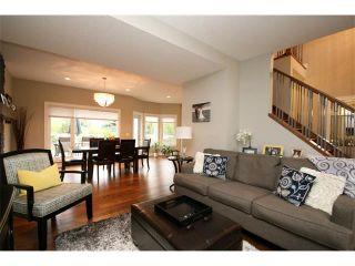 Photo 7: 156 GLENEAGLES Close: Cochrane House for sale : MLS®# C4018066
