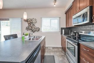 Photo 5: 298 SUNSET Point: Cochrane Row/Townhouse for sale : MLS®# A1033505
