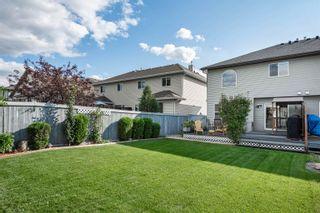 Photo 39: 124 CASTLE Drive in Edmonton: Zone 27 House Half Duplex for sale : MLS®# E4260271