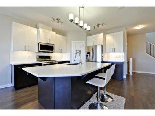 Photo 5: 140 FIRESIDE Place: Cochrane House for sale : MLS®# C4004650