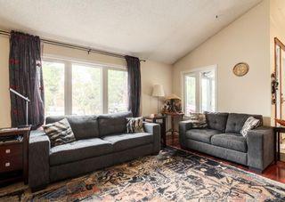 Photo 4: 12 Deerfield Drive SE in Calgary: Deer Ridge Detached for sale : MLS®# A1136598