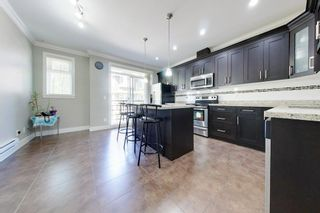 """Photo 15: 77 6383 140 Street in Surrey: Sullivan Station Townhouse for sale in """"PANORAMA WEST VILLAGE"""" : MLS®# R2573308"""
