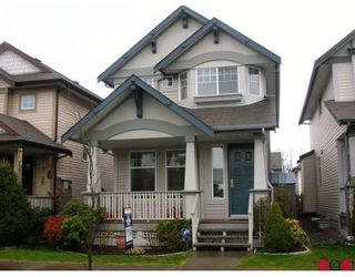 """Photo 1: 18519 67A Avenue in Surrey: Cloverdale BC House for sale in """"Heartland"""" (Cloverdale)  : MLS®# F2809509"""