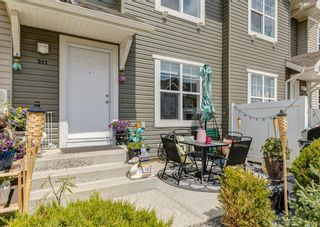 Photo 2: 311 Toscana Gardens NW in Calgary: Tuscany Row/Townhouse for sale : MLS®# A1118245