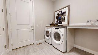 Photo 18: 20 Cranbrook Mews SE in Calgary: Cranston Semi Detached for sale : MLS®# A1020402