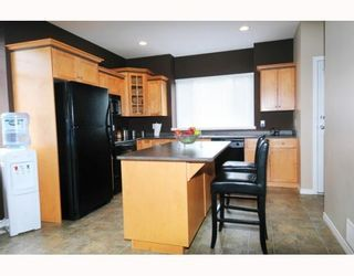 Photo 3: 23605 DEWDNEY TRUNK RD in Maple Ridge: Condo for sale : MLS®# V757687