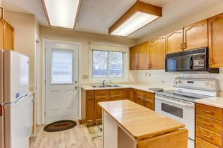 Photo 6: 2619 Dovely Court SE in Calgary: Dover Row/Townhouse for sale : MLS®# A1152690