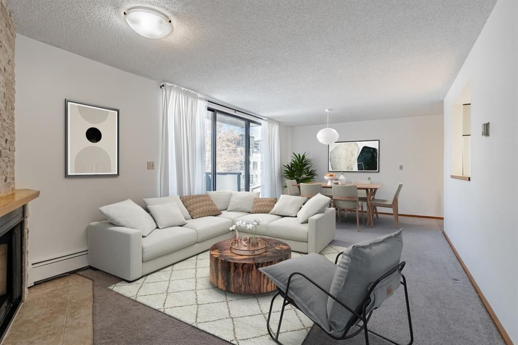 HUGE POTENTIAL! Spacious and bright living room with huge wrap around balcony (Virtually staged image).